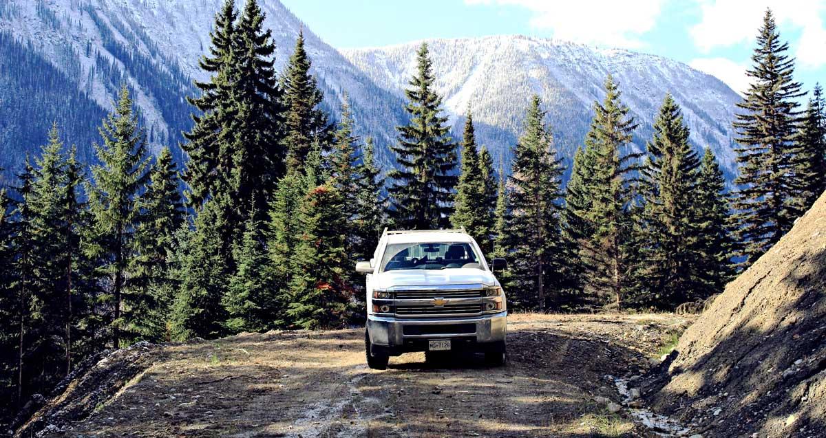 A Chevy Silverado parked in a mountain area