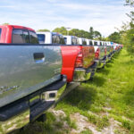 A row of Toyota trucks in a field