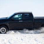 View of a Toyota Tundra traveling in a snowy road